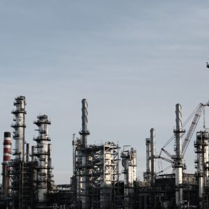 """Chevron's CEO says """"action over pledges"""" will deliver higher returns, lower carbon"""